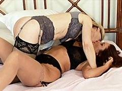 Lesbian MILFS kiss and play in the bedroom before working each others pussys